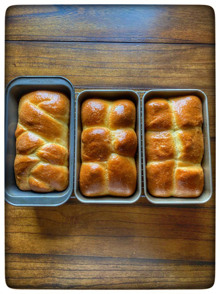 brioche bread in pans on table